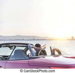 Relaxing woman on the beach in the car. - Relaxing woman on...