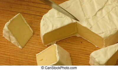 Camembert cheese tasting sliced - Fresh brie cheese with...