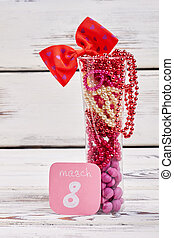 Glass with beads and dragee. 8th March greeting.