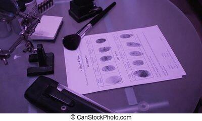 Fingerprint on police fingerprint card. Motion