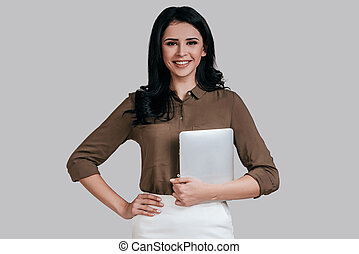 Modern woman. Attractive young woman in smart casual...