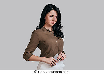 Young and smart. Attractive young woman in smart casual wear...