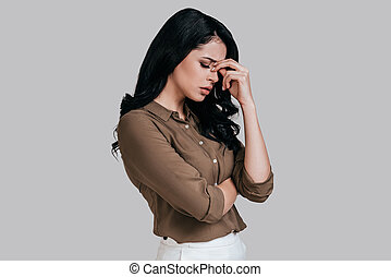 Feeling tired and stressed. Frustrated young woman in smart...