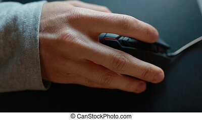 Young man play game using mouse. Closeup. - Young man play...