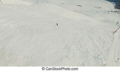 Snowboarder on the slope. Aerial footage.