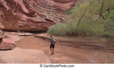 Backpacker Girl exploring Coyote Gulch Grand Staircase...