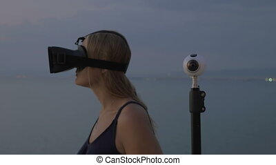 Woman in VR-headset and 360 degree camera - Woman using...
