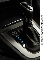 Automatic transmission stick with blue light of modern sedan...