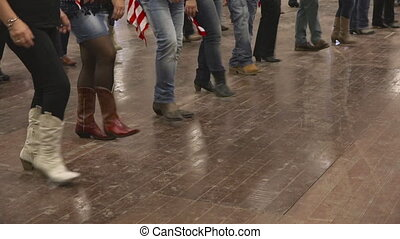 Western dancer dancing line dance at country festival USA flag