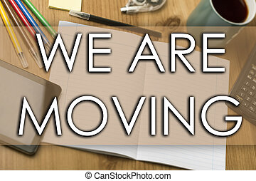 WE ARE MOVING - business concept with text
