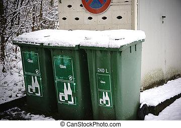 Snowbound garbage bins - Snowbound glass waste stand against...