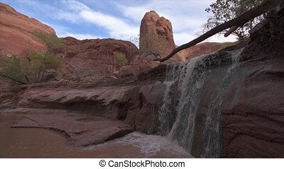 Waterfall on a lower section of the Coyote Gulch Escalante...