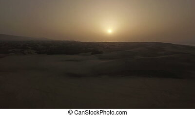 Aerial scene of sand dunes at sunset - Flying over vast sand...