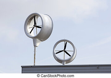 urban windmill on roof of new building in the netherlands...