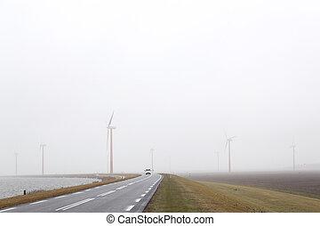 wind turbines in misty field near Almere in the netherlands...