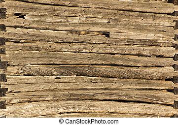 Background pioneer log cabin barn wall in sunshine - Closeup...