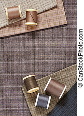 Spools of threads on checkered cotton fabric for quilting...