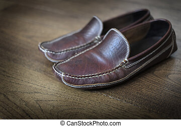 Comfortable Leather Slippers on Polished Wooden Floor