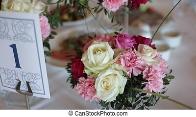 Flowers decoration on table with pink peony and white roses