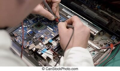Shot soldering a circuit board with a soldering iron - Close...