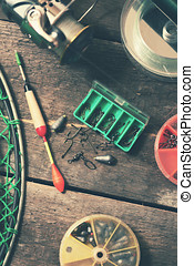fishing tackle on old wooden table. top view