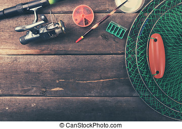 fishing equipment on old wooden table with copy space