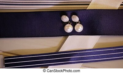 Earrings with pearls on blue and white navy ribbons