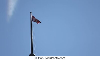 Russian navy flag on tower at windy day