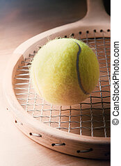 Retro Wooden Tennis Racquet with Ball on Table - Retro...