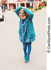 Outdoor fashion portrait of adorable little girl of 8-9 year...