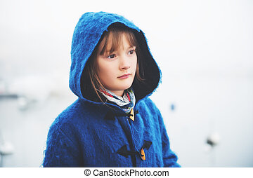 Outdoor portrait of little 9-10 year old little girl on a...