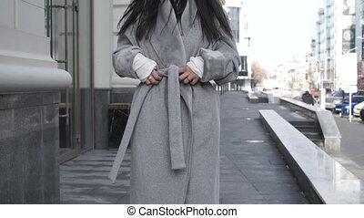 Stylish female walking in city looking up - Stylish female...