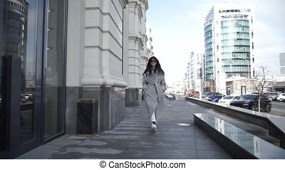 Stylish female walking in city street - Stylish young female...