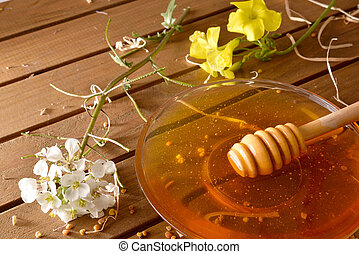 Jar honey with honeycomb on wood table elevated view - Jar...
