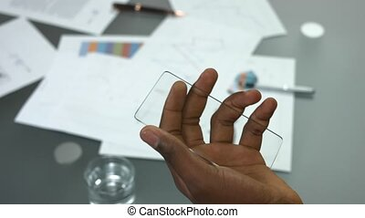 Male hands and transparent phone. Man touching blank...