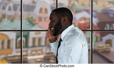 Afro-american guy on the phone. Businessman on town...