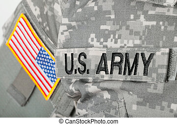 Close up studio shot of U.S. ARMY and USA flag patches on solders uniform