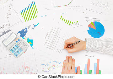 Businessman at the table with diferent financial data -...