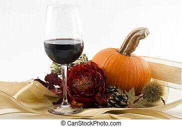 Autumn Wine - A glass of red wine with red blossom,seasonal...