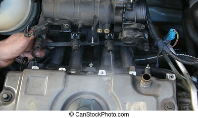 Car engine injectors spraying - Car mechanic examine fuel...