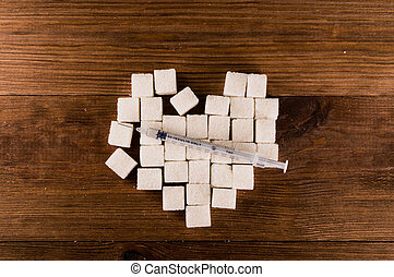 Diabetes is terrible disease. Heart of sugar cubes with...
