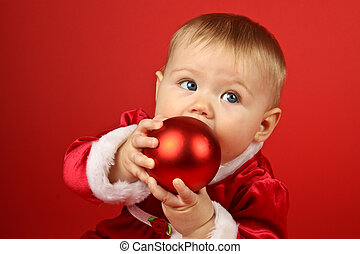 Christmas Baby - Blond baby girl in red holiday dress on red...
