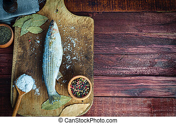 Fresh fish smelt spices for cooking on a kitchen board, top...