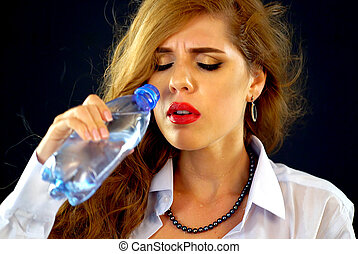 Sensitive teeth woman drinking cold water from bottle....