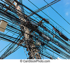 Intertwining of many electrical wires on poles