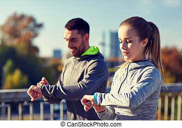 couple running over city highway bridge - fitness, sport,...