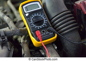 multimeter or voltmeter testing car battery - auto service,...