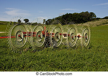 hay rake on a farming grass field