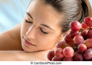 Woman relaxing at wine therapy. - Close up portrait of...