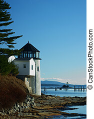 New England lighthouse - A stunning view of a lighthouse on...